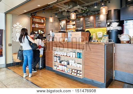 HONG KONG - NOVEMBER 03, 2015: Starbucks cafe at Hong Kong Airport. Hong Kong International Airport is the main airport in Hong Kong. It is located on the island of Chek Lap Kok.