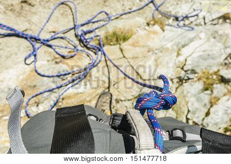 Eight knot tied to a climbing harness.