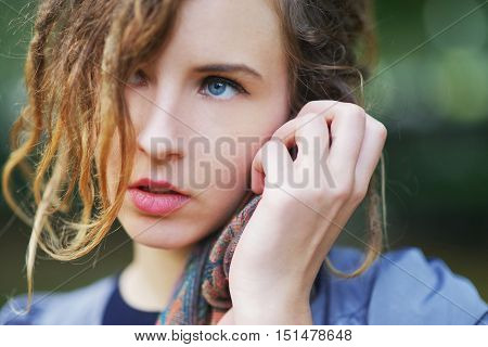 portrait of a beautiful charming girl with expressive eyes in the Park in autumn day close up.
