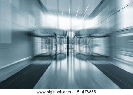 Blurred image of the entrance of the modern business city office building.