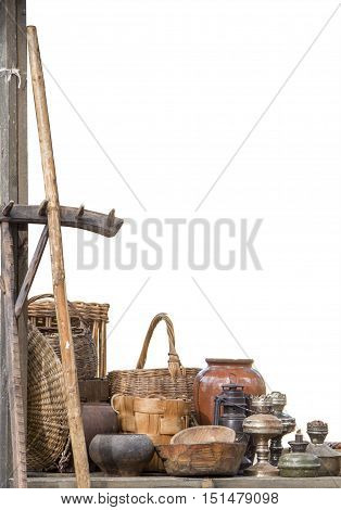 composition of items made by hand at the county fair isolated on white. Baskets ceramic rakes old kerosene lamp wooden bowls.