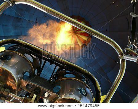 Flame of a burner inside a hot air balloon