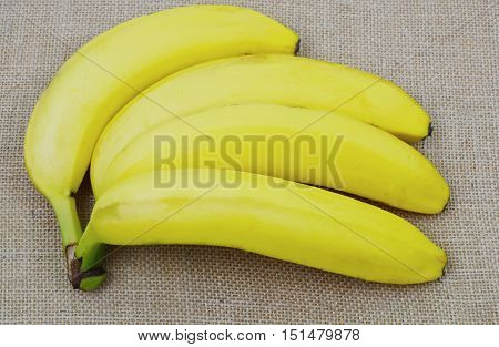 Possible health benefits of bananas with wooden background