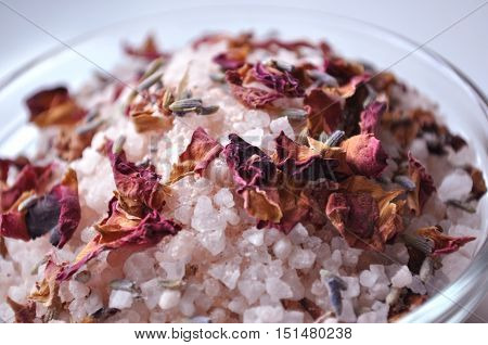 Luxurious spa bath salts in a glass bowl, close-up