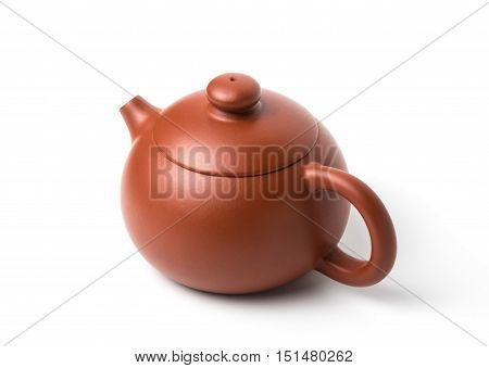 Small brown earthenware teapot with closed lid isolated on white background