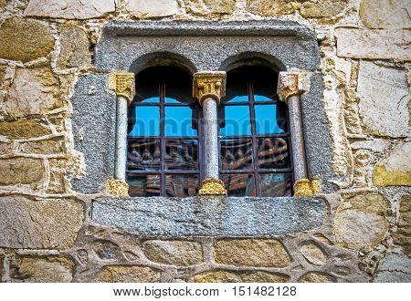 Old window in ancient house in Avila, Spain
