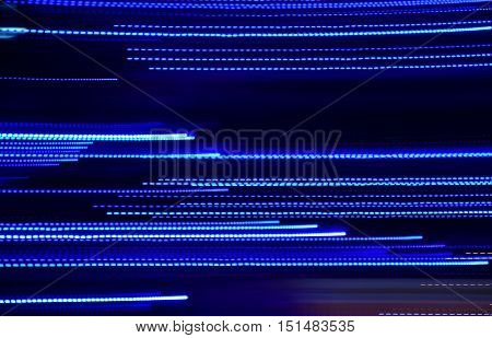 Abstract blue luminous lines background. High speed