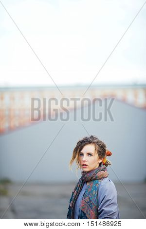 Portrait of beautiful pensive girl in the town square.