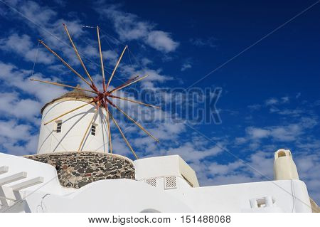 View of Oia windmill at the Island Santorini, Greece. Lot of copyspace.