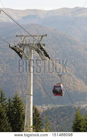Cableway in Romanian Carpathians during summertime with passenger cabin moving