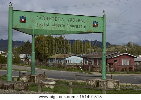 Sign commemorating the construction of the Carretera Austral in the small town of La Junta in Aysen Region of southern Chile.