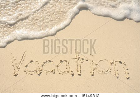 Vacation Written In Sand On Beach