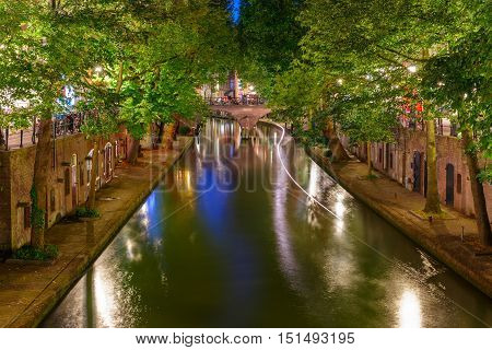 Unique embankments with two levels along the Oudegracht at night, Utrecht, Netherlands
