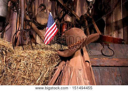 Small American flag sticking out of a bale of hay.
