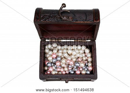 Small wooden casket and color necklace isolated on white background with clipping path