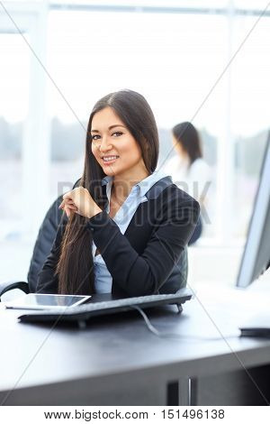 portrait of a young woman administrator at work place