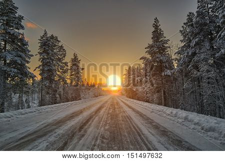Bright Colorful Winter Polar Night Sunset over road in Lapland, Finland