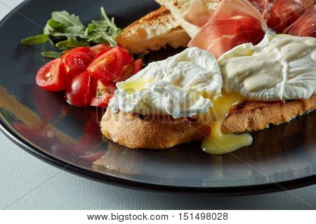 Poached egg on a piece of bread