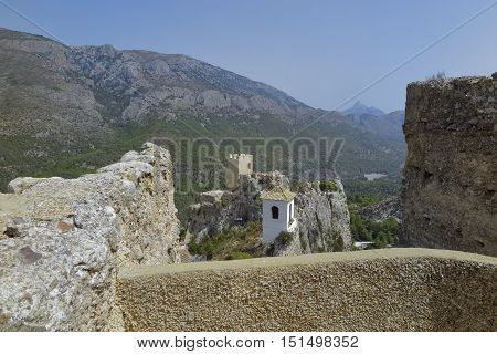 view of the valley the bell tower and the castle tower from a lookout on el castell de guadalest in the province of alicante spain