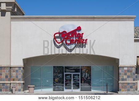 Guitar Center Retail Store And Logo