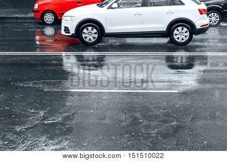 Cars Driving Through Water Puddles During Rainy Day