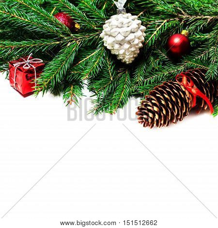 Christmas fir tree brunch isolated with decoration over white background. Xmas vivid holiday Card with copyspace