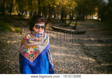 Portrait Of An Adult Woman In Russian National Scarf. Pavloposadskiye Scarf Blue