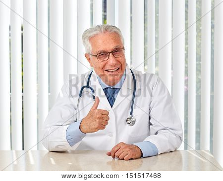 Elderly doctor man in hospital.
