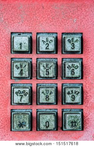 Old button number/numpad of public coin telephone. Obsolete concept. Selective focus.