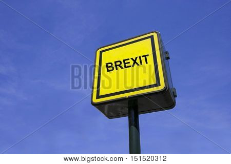Yellow Sign Up Against Blue Sky with text saying Brexit