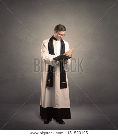 young priest in giving his blessing