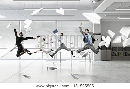 Dancing businesspeople in office room . Mixed media