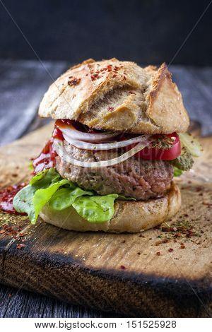 Barbecue Hamburger with Salad Leaf on Cutting Board