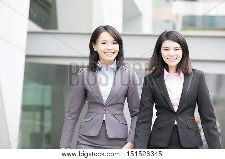 two business woman smile to you in hongkong asian