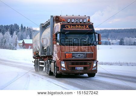 SALO FINLAND - JANUARY 16 2016: Volvo FH silo transport truck moves along icy and snowy road in South of Finland in winter.