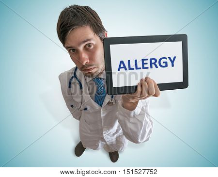 Doctor Is Showing Tablet And Warning Against Allergy. View From