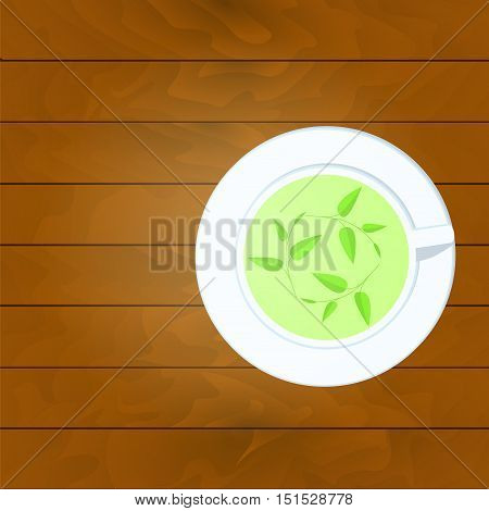 Cup Of Green Herbal Tea On Wooden Background