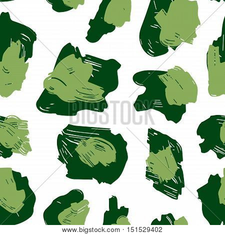 The texture of the leopard spots. Leopard pattern for textiles. Green spots on a white background. Pattern in khaki colors