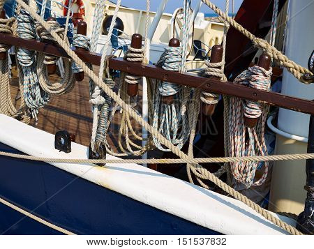 Old traditional wooden sailing boat sails and rigging on sea