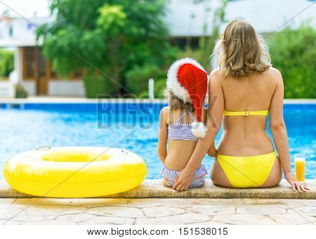 Little Girl And Her Mother Celebrates Christmas In Warm Country.