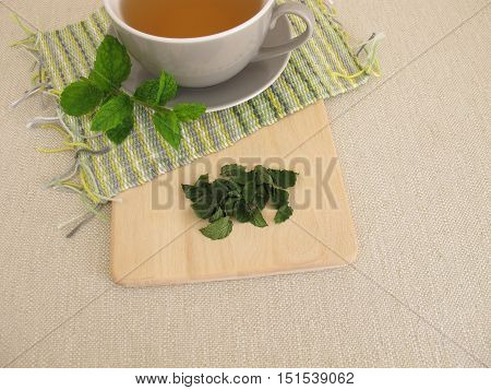 Peppermint tea and fresh and dried peppermint leaves