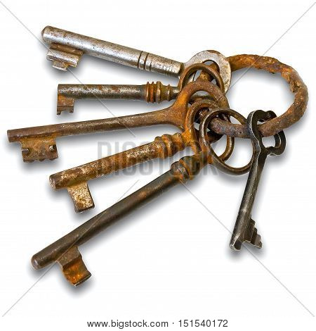 Old keys on a metallic ring on a white background
