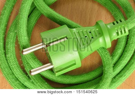 Green wire with a plug coiled like a snake.