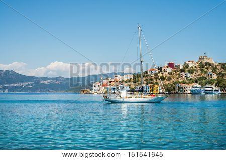 Yacht in bay of Kastelorizo island on sunny summer day, Dodecanese, Greece