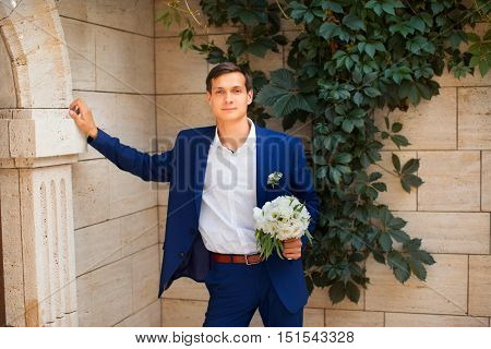 Portrait of the groom in an expensive suit