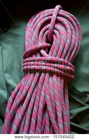 Pink climbing rope close up.