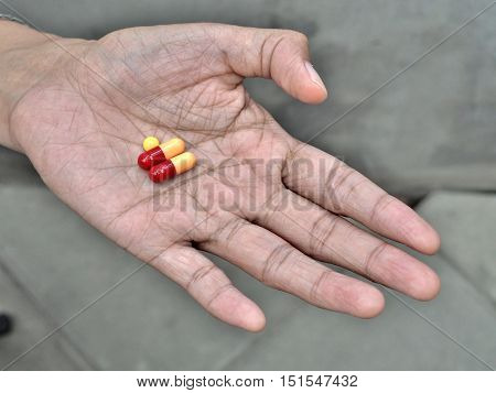 elder hand holding or offering pills, concept of healthy and medical.