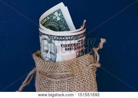 US dollars in a brown hessian sack.
