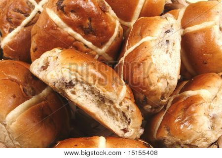 A close up of hot cross bun
