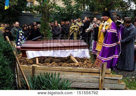 Uzhhorod Ukraine - 2016. October 12: The priest buries heroic deceased Ukrainian soldier on the Hill of Glory.